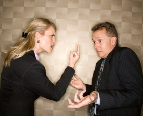 Businesswoman Flipping off Businessman